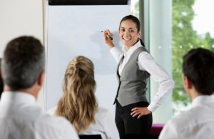 Woman using whiteboard in business meeting